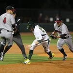 """Oregon's Mark Karaviotis (24) is caught in """"no mans land"""" in a game with New Mexico at PK Park on Thursday, Feb. 19 , 2015, in Eugene, Ore."""