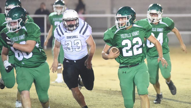 Yellville-Summit's Brock Vigna (22) rushes against Marshall on Friday night at Panther Field. Vigna surpassed 1,000 rushing yards for the season with 134 yards on Friday.
