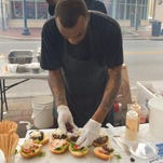 Nick Farkas, executive chef at Pensacola Cooks Kitchen, shows off a dish he made previously for the Pensacola News Journal for TasteMakers.
