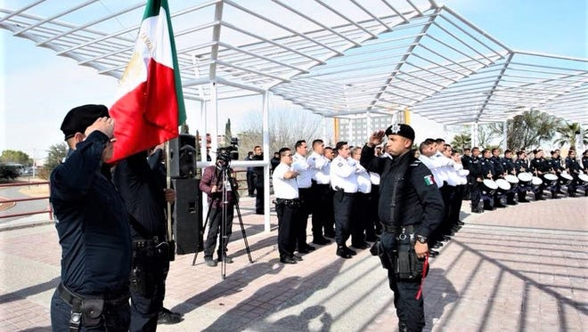 Fallen officers are honored Tuesday during an International Day of the Police ceremony in Juárez.