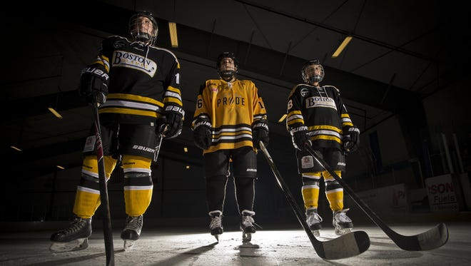 Kate Gray, left, Amanda Pelkey, center, and Maggie DiMasi are all in their first year playing professional women's hockey, Gray and DiMasi for the Boston Blades, Pelkey for the Boston Pride.