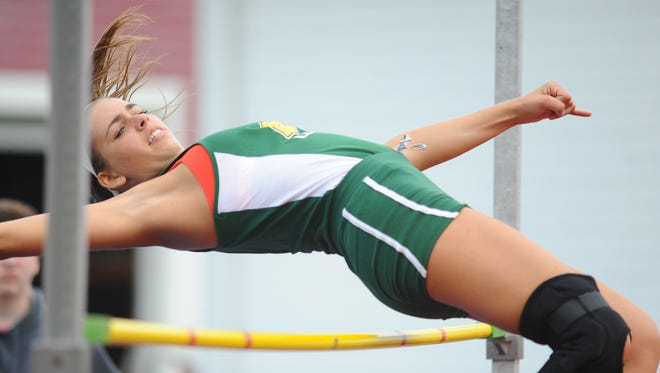 Audubon's Alyssa Davis clears the bar in the high jump at the George Rowland Relays at Haddon Township on Saturday.