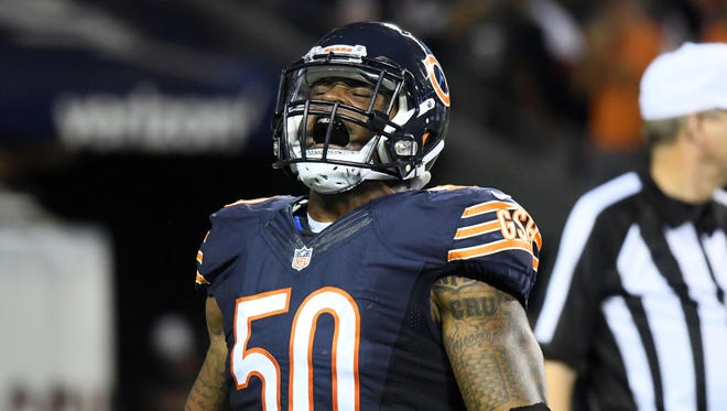 Chicago Bears inside linebacker Jerrell Freeman (50) reacts after making a tackle against the Philadelphia Eagles during the second quarter at Soldier Field.