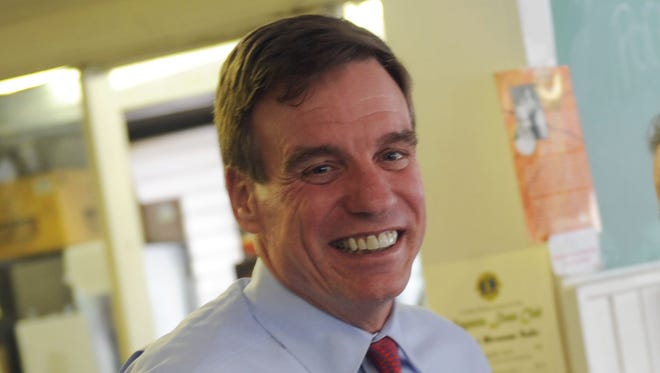 Mike Tripp/The News Leader U.S. Sen. Mark Warner, D-Va., turns around and smiles as U.S. Senate candidate Tim Kaine picks up the tab for their milkshakes as well as milkshakes for all those traveling with them. Traveling from Harrisonburg to Charlottesville, Warner and Kaine made a quick stop at Wright's Dairy-Rite in Staunton on Thursday, March 5, 2012.