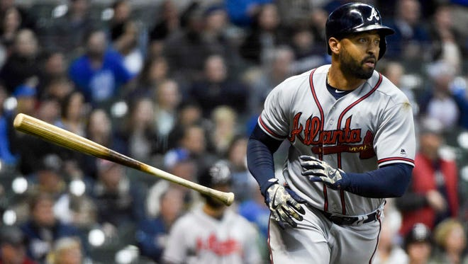 Braves leftfielder Matt Kemp  watches after hitting a two-run homer in the eighth inning against the Brewers at Miller Park.