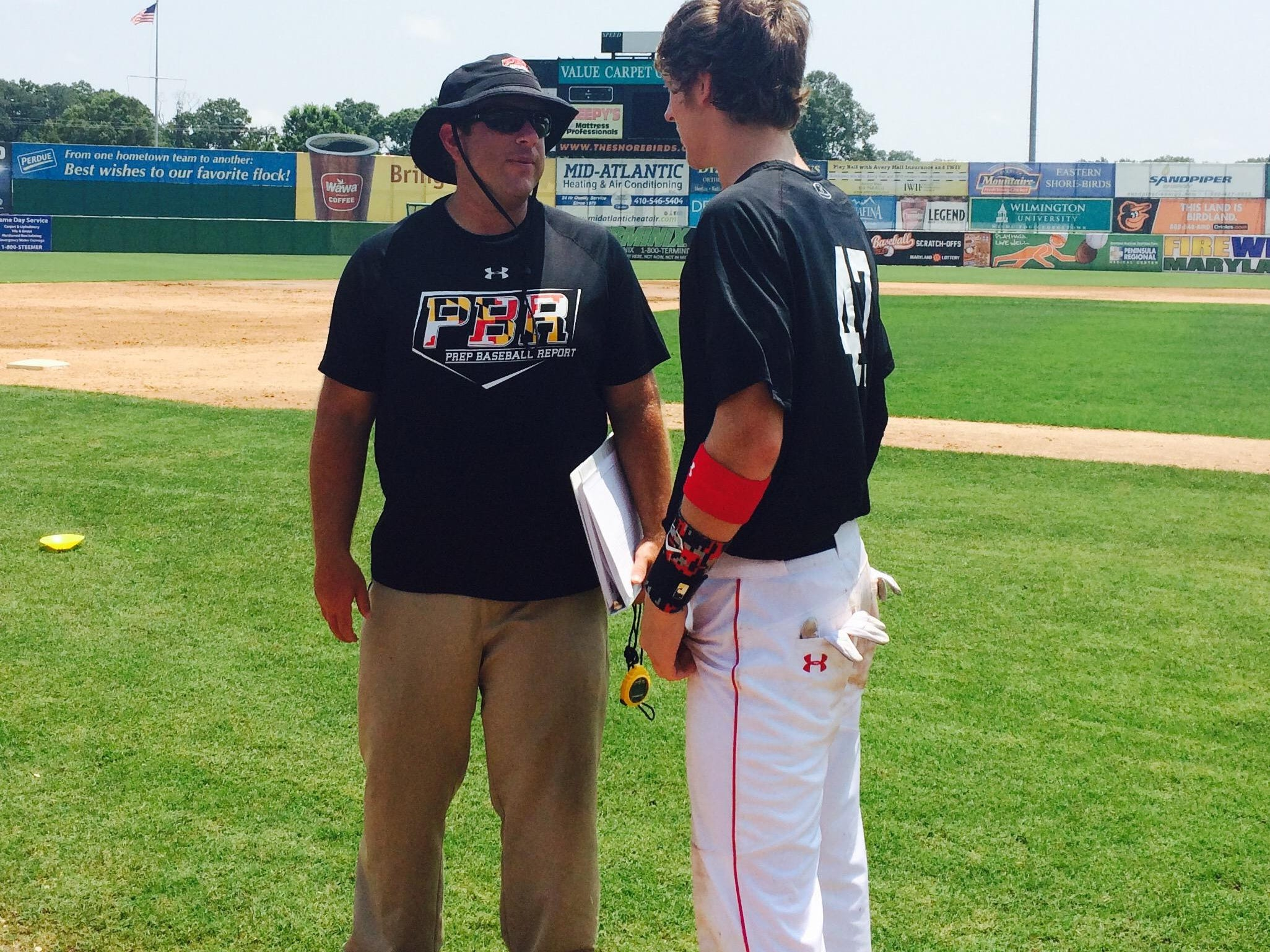 Jerry Shank, left, the PBR director of scouting for Maryland, talks with a player after the showcase.
