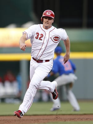 Cincinnati Reds right fielder Jay Bruce (32) heads to third on his way to scoring on a double by third baseman Todd Frazier (21) in the first inning.