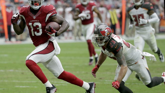 Arizona Cardinals wide receiver Jaron Brown (13) runs after the catch for a touchdown against the Tampa Bay Buccaneers on Sunday in Glendale, Arizona.