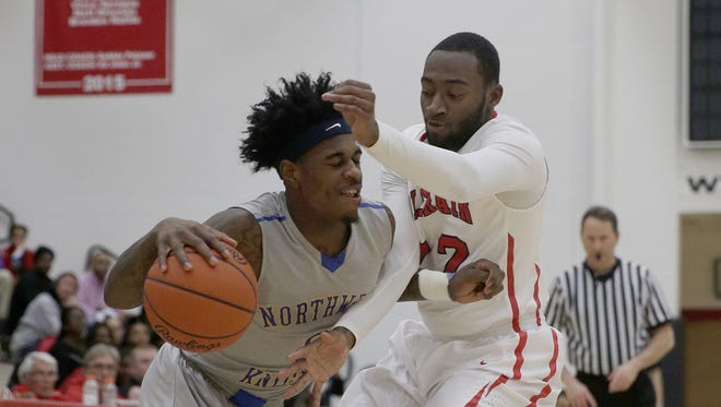 Northwest's Ronnell Turner drives past Colerian's Eric Phillips.
