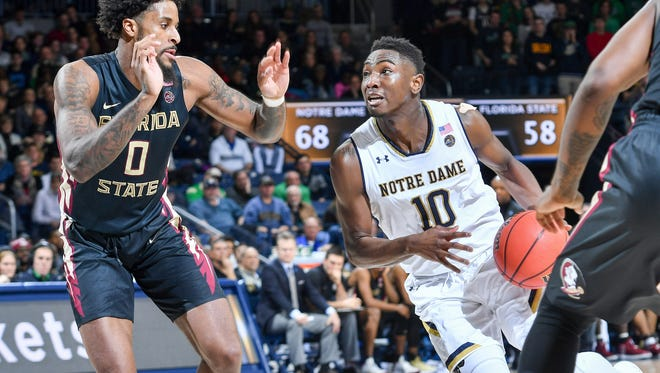 Feb 10, 2018; South Bend, IN, USA; Notre Dame Fighting Irish guard T.J. Gibbs (10) drives to the basket as Florida State Seminoles forward Phil Cofer (0) defends in the second half at the Purcell Pavilion. Mandatory Credit: Matt Cashore-USA TODAY Sports
