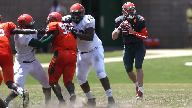 Quarterback Ryan Stanley looks for a pass during the FAMU spring game held Saturday, April 21, 2018 at Bragg Memorial Stadium.