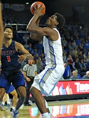 MTSU forward Brandon Walters goes up for a shot in