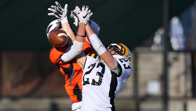 Cascade defensive back James Baxter (23) breaks up a pass against Scappoose during the OSAA 4A state championship game, Saturday, November 28, 2015, at Hillsboro Stadium in Hillsboro, Ore. Cascade won the game 37-28.