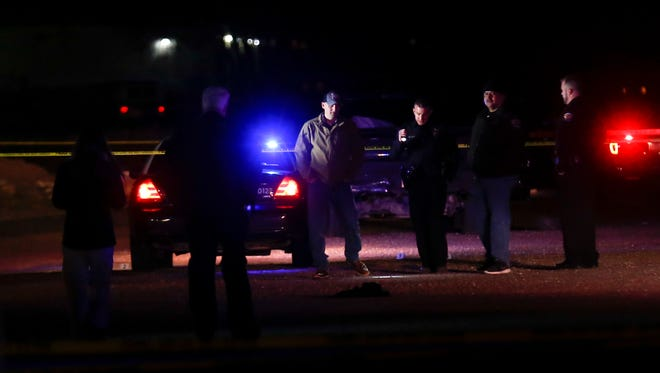 Farmington Police officer investigate an officer involved shooting Wednesday, Dec. 20, 2017