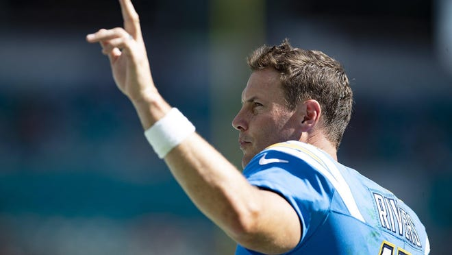 Los Angeles Chargers quarterback Philip Rivers waves to the crowd during a win over the Dolphins in September.