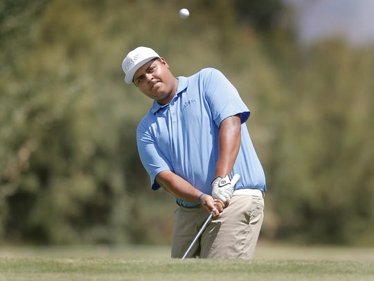 Defending champion Mike Soto chips onto the green on the fifth hold Friday at the 71st annual Anthony Invitational Golf Tournament at Anthony Country Club in New Mexico.