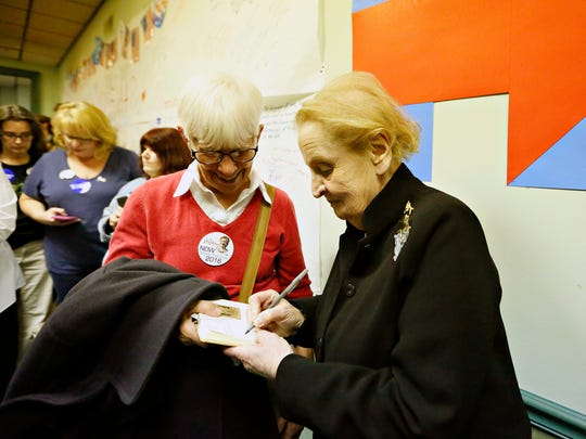 Former Secretary of State Madeleine Albright, right, autographs a book for Jeanna Buckingham, of York City, after Albright rallied canvassers on behalf of Hillary Clinton at Hillary Headquarters in York City, Sunday, Nov. 6, 2016. The autograph is for Buckingham's husband, who is also Czechoslovakian, like Albright. Dawn J. Sagert photo