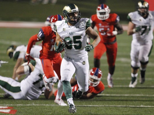 CSU running back Izzy Matthews runs through the Fresno State defense for a touchdown in the 2016 regular-season finale. Matthews, a true freshman, averaged 6.6 yards a carry in the final six games of the season.
