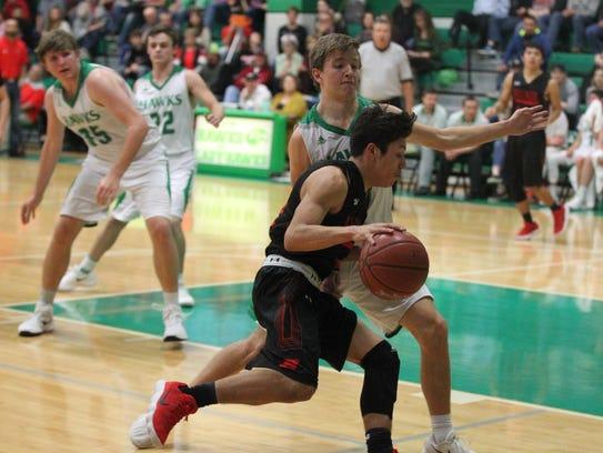 Ballinger High School's Edgar Nunez (21) tries to work