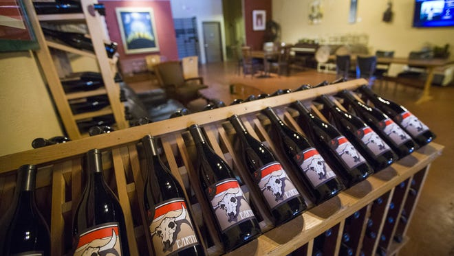 Grenache blend and the interior at the Fire Mountain tasting room in Cottonwood.