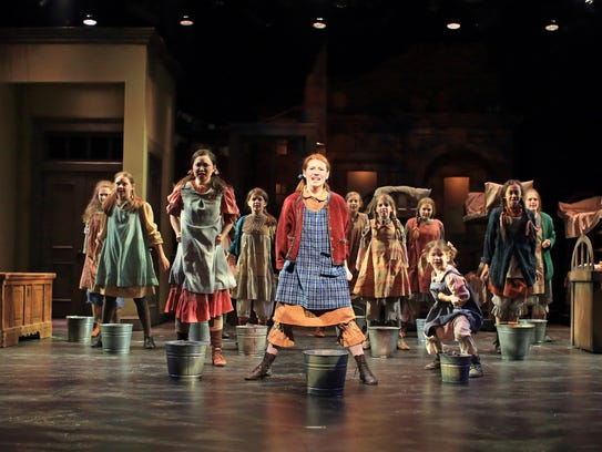 Carly Gendell (Annie, center) and the orphan ensemble