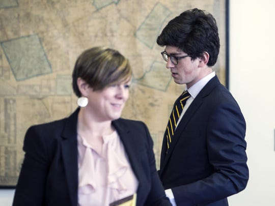 Owen Labrie enters the Merrimack County Superior court with his attorney Robin Melone during the first day of a hearing on whether he deserves a new trial, on Tuesday, Feb. 21, 2017 in Concord, N.H. Labrie claims his trial lawyers failed to challenge the felony charge. He was acquitted in 2015 of raping a 15-year-old classmate as part of a game of sexual conquest at St. Paul's School but was convicted of a felony computer charge requiring him to register as a sex offender.