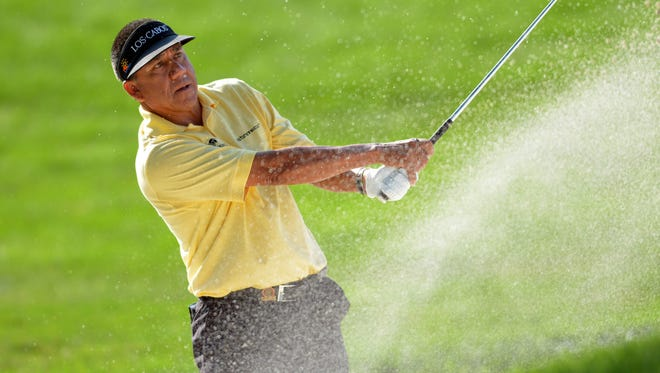 Esteban Toledo hits out of the bunker on the second hole during the second round of the 2013 U.S. Senior Open on July 12, 2013, at the Omaha Country Club.