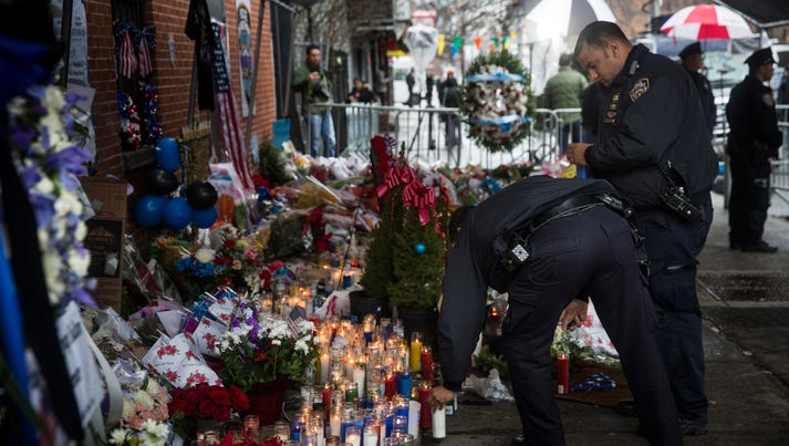 New York police pay respects on Dec. 23, 2014 at the