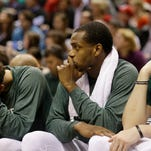 Milwaukee Bucks' Michael Carter-Williams, left, Khris Middleton and Ersan Ilyasova, right, watch the second half of Game 6 against the Chicago Bulls Thursday in Milwaukee.
