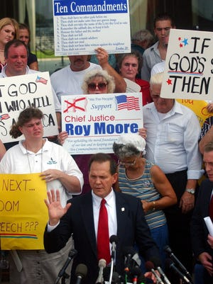 Alabama Chief Justice Roy Moore in front of the State Judicial Building in Montgomery in 2003.