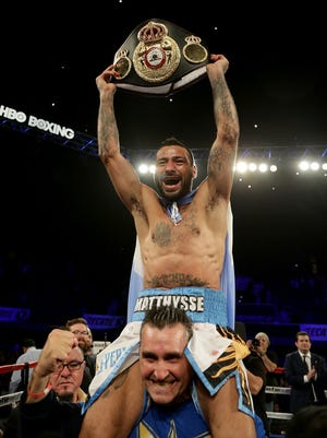 Lucas Matthysse celebrates his victory over Tewa Kiram  at The Forum in Inglewood, Calif.