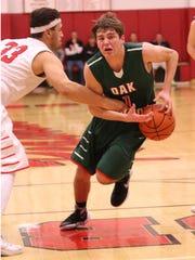 Oak Harbor's Matt Harris drives the lane Friday against