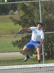 Jack Arp serves against Searcy.