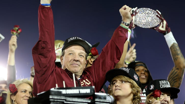 Head coach Jimbo Fisher, along with his son Trey, celebrates winning the national title in Pasadena.  Glenn Beil/democrat Head Coach Jimbo Fisher, along with his sone Trey celebrate after Florida State defeats Auburn 34-31 to take the BCS National Championship game on Monday Jan., 6, 2014. The Florida State Seminoles used late game heroics to take down the Auburn Tigers at the Rose Bowl in Pasadena, CA.