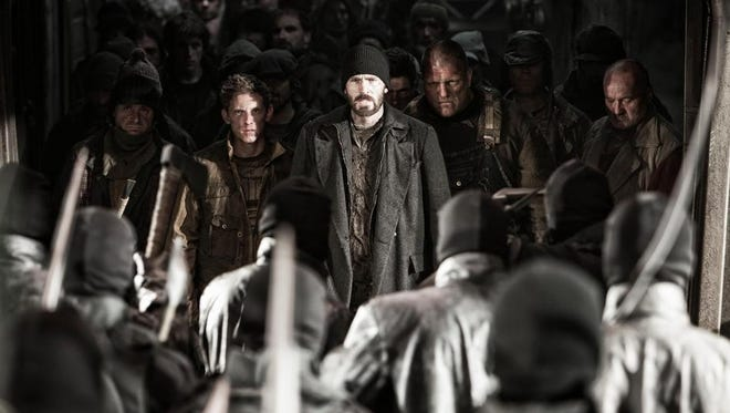 """Chris Evans (center) stars as Curtis in the post-apocalyptic world of """"Snowpiercer."""""""