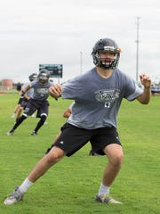 Aaron Sanchez, Oñate High Schools quarterback during practice Tuesday August 1, 2017