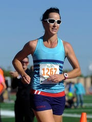 Hellois Scheeres finishes the Sioux Falls Marathon at Howard Wood Field on Sunday in Sioux Falls. Scheeres is the first woman to finish the marathon.