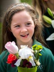 Holy Name School student Mila Thompson, 6, participates