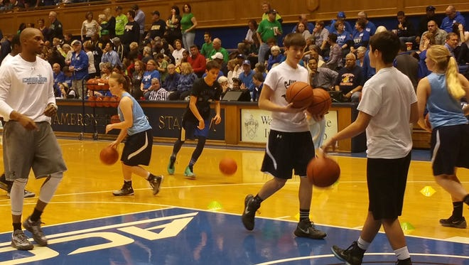 Six players from Team Carolina Asheville and John Williams Basketball Elite Training did a training demonstration at halftime of Monday's Duke-Notre Dame women's game in Durham.