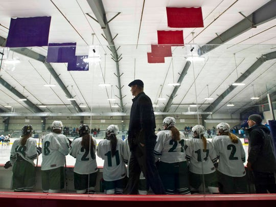 Rice Memorial girls hockey coach Aaron Miller walks the bench during a game against South Burlington on Thursday.