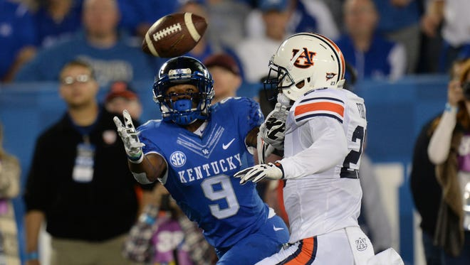 UK WR Garrett Johnson makes the a catch during the first half of the University of Kentucky - Auburn football game at Commonwealth Stadium in Lexington, Ky., on Thursday, October 15, 2015.
