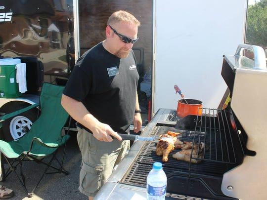 James Hart, former Westland Area Jaycees president, tends to the barbecue during the organization's inaugural All American BBQ Throwdown last year.