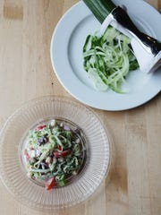 """This Greek salad is prepared with a twist of spiralized cucumber """"noodles."""""""