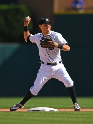 Tigers second baseman Ian Kinsler completes a double play against the Dodgers in the fourth inning at Comerica Park on Aug 19, 2017.