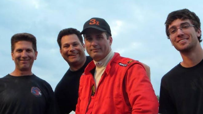 Sprint-car driver Scott Semmelmann, in red, died in a crash in warm-up laps at Beaver Dam Raceway.