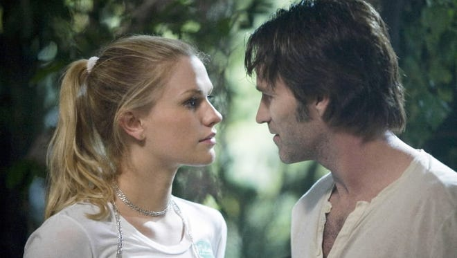 """Many moons ago: A scene from the first night Sookie (Anna Paquin) met """"Vampire Bill"""" (Stephen Moyer). 'True Blood' will end with Season 7 next summer."""