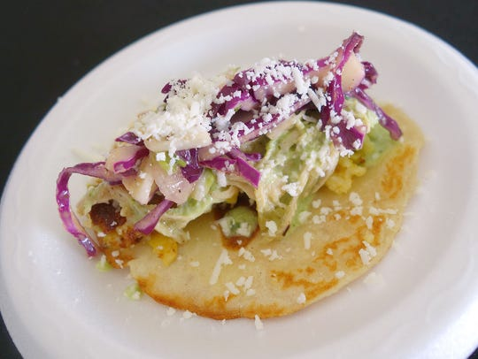 Tomatillo chicken taco with half and half corn and