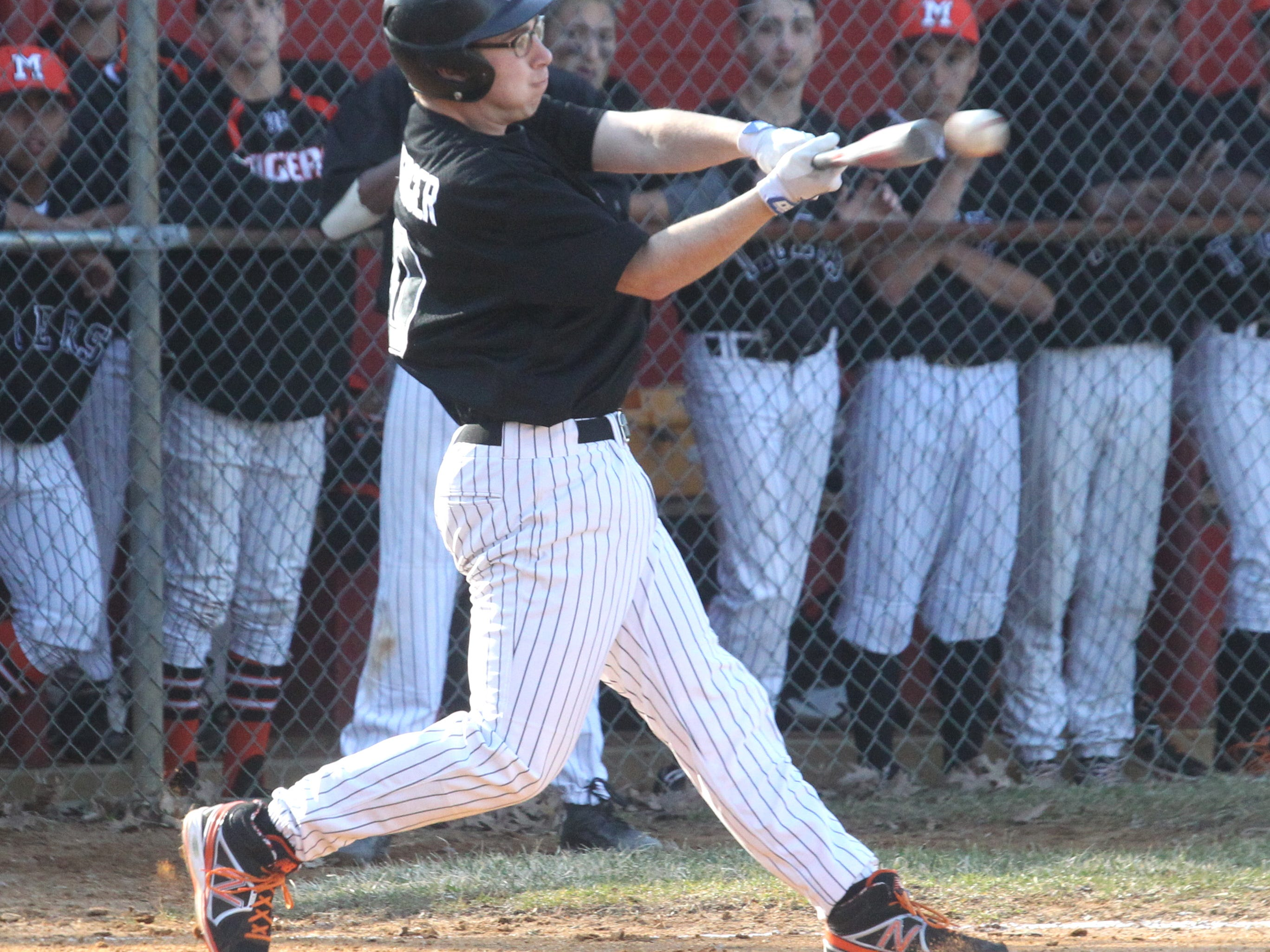 Mamaroneck's Ben Steinberger drives in two runs at North Rockland Apr. 6, 2015. Mamaroneck won 3-2.