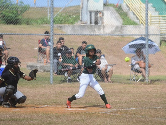 Emani Gutierrez bats for the defending champion John F. Kennedy Islanders during their Independent Interscholastic Athletic Association of Guam Girls Softball League opening game against the Tiyan High Titans at JFK High School on Jan. 20, 2018. The Islanders defeated the Lady Titans 16-1, ending the game by a mercy rule in the fourth inning.