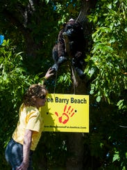 Bonnie Jorgenson stands with a gorilla decoration in